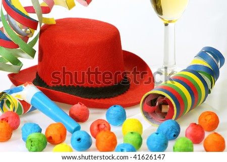 Red hat and party goods on bright background - stock photo