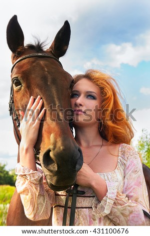 Red head girl and a horse