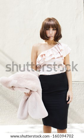 red head lady looking at camera with elegant clothes