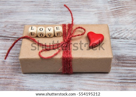 Red heart and word love on gift for Valentine's Day