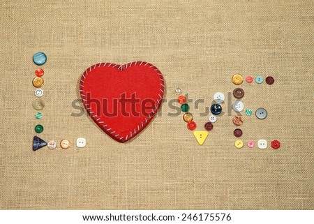 Red heart and word love writing with different sewing buttons - stock photo