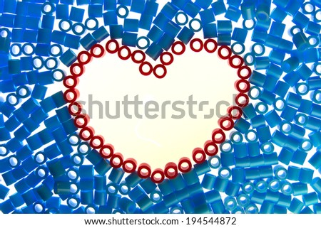 red  heart bead on white background. - stock photo
