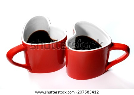 Red heart cup of coffe on the table - stock photo