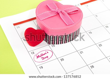Red Heart heart shaped gift box on calendar
