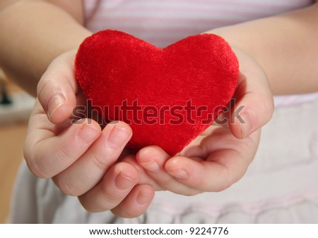 red heart in child hands