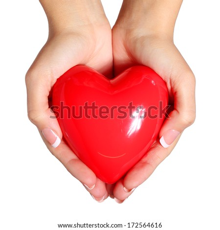 Red heart in female hands, isolated on white background. Love Concept