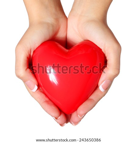 Red heart in female hands, isolated on white. Love Concept