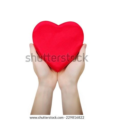 Red heart in hand isolated on white