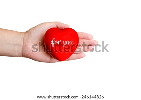 Red heart in hand with love text - stock photo