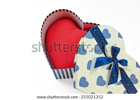Red heart in heart shape gift box on white background. - stock photo