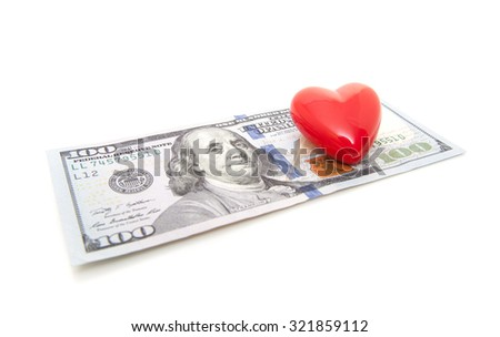 Red heart in hundred dollar note. All on white background. - stock photo