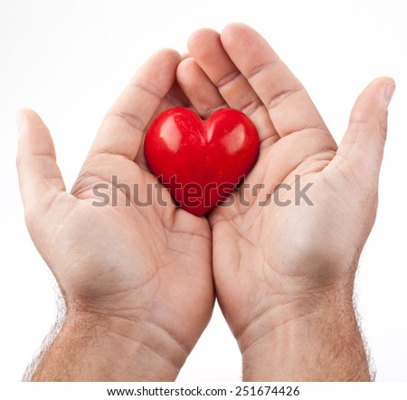 Red heart in male hands on a white background.