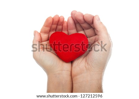 Red heart in the couple hands