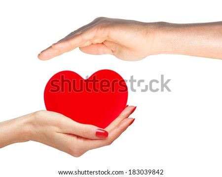 Red heart in woman and man hands isolated on white background