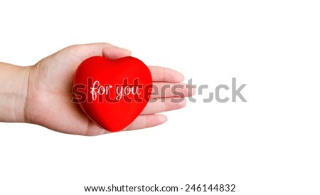 Red heart in woman's hand - stock photo