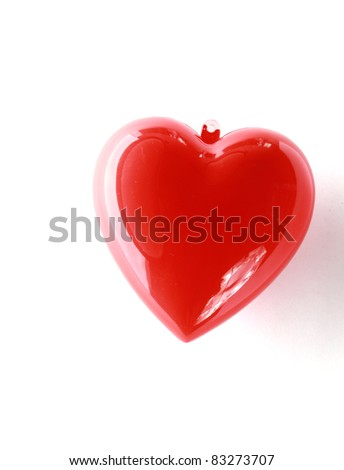 Red heart isolated over white background