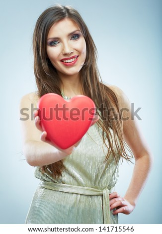 Red heart. Love symbol. Portrait of beautiful woman hold Valentine day symbol. Isolated studio background female model.