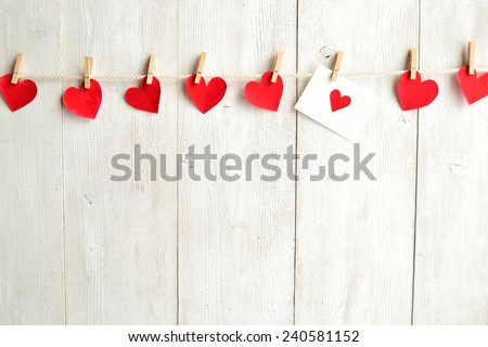 Red heart message card with red heart paper cut out - stock photo