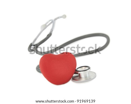Red Heart next to Medical Stethoscope isolated on white background