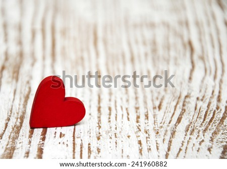 Red heart on a old wooden  background - stock photo