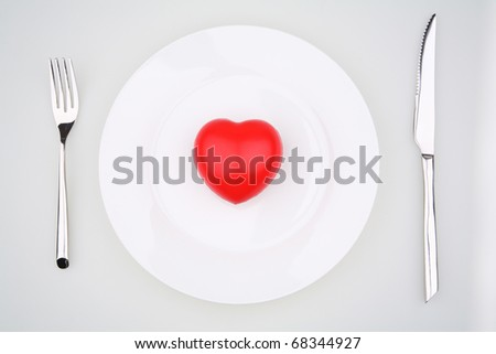 red heart on a plate with knife and fork