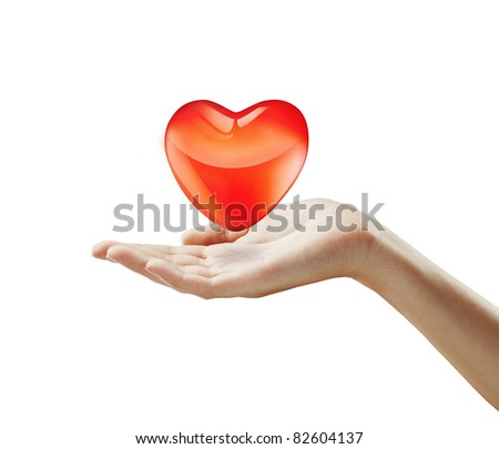 Red  heart on a woman's hand.Heart on the palm - love symbol.Isolated on a white background - stock photo