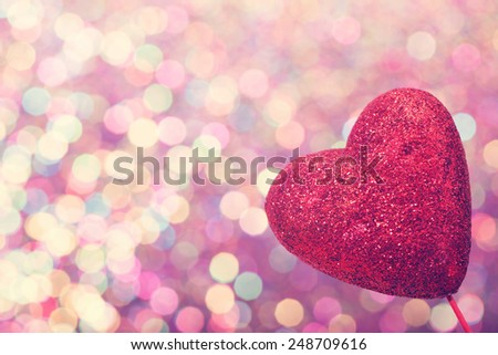 Red heart on abstract shiny colorful light background - stock photo
