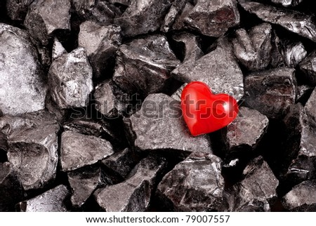 Red heart on black natural stones - stock photo