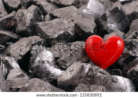 Red  heart on black stones, valentines day background - stock photo
