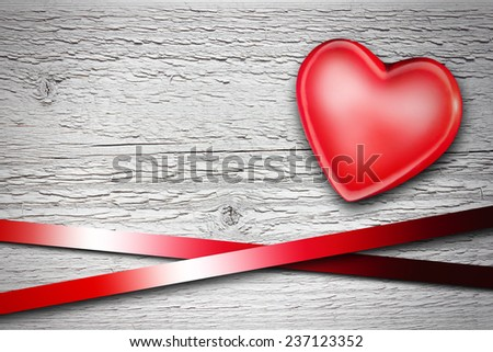 red heart on old shabby wooden background - stock photo