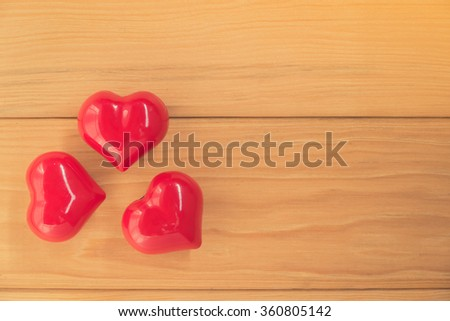 red heart on rustic wood with copy space, valentine background - stock photo