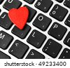 Red heart on the computer keyboard - stock photo