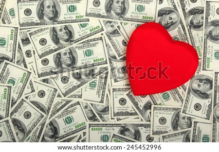 red heart on the dolar background - stock photo