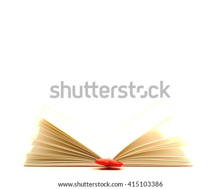 Red heart on the open book isolated on white background, select focus.  - stock photo