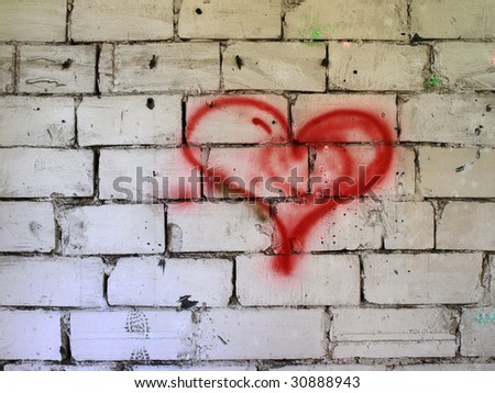 Red heart on wall. - stock photo