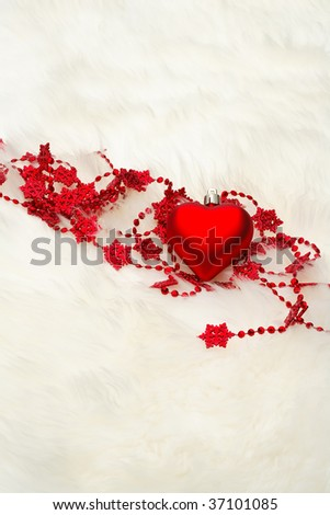 Red Heart on white fur - stock photo