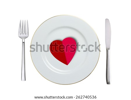red heart on white plate, spoon and fork isolated on white - stock photo