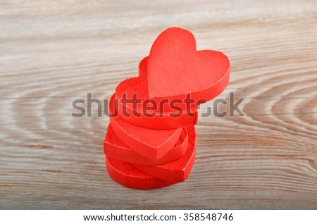 Red heart on wooden background, card for Valentine's day