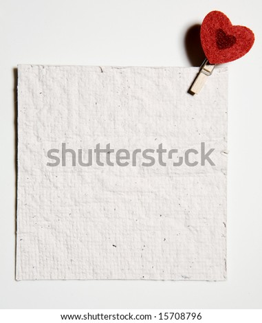 red heart peg holding a note