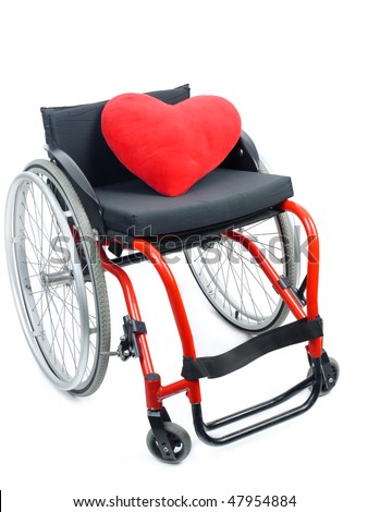Red heart pillow on wheelchair isolated on white background - stock photo