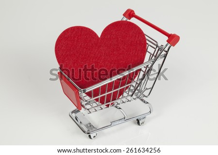 red heart shape in a shopping cart - stock photo
