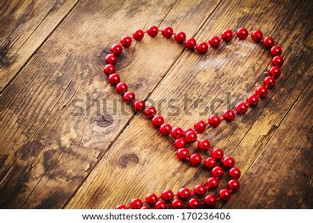 Red heart shape pearl necklace. - stock photo