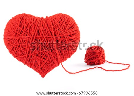 Red heart shape symbol made from wool isolated on white background. Valentine - stock photo