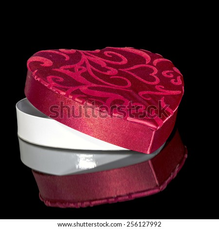 Red heart shaped box with reflection - stock photo