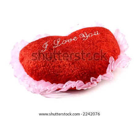 Red heart shaped cushion Valentine concept on white background