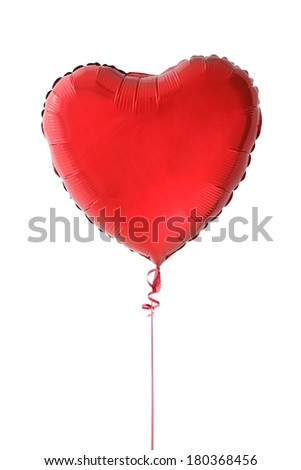 Red heart shaped foil balloon on white - stock photo