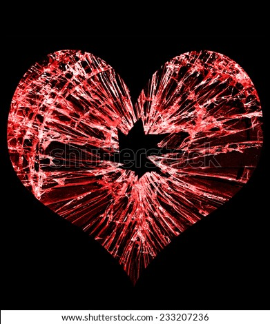 red heart shaped glass with a hole in the middle                                - stock photo