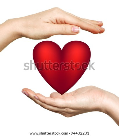 Red heart symbol in woman's hands isolated on white