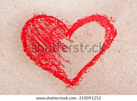 Red heart symbol on a paper with chalk - stock photo