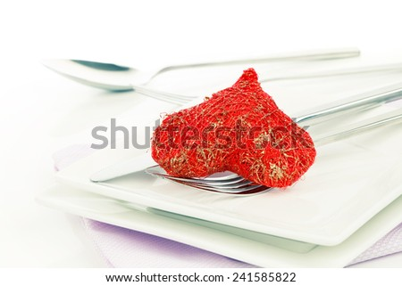 Red heart with fork. Concept image for Valentine dinner/love food/love cooking etc. Copy space. - stock photo